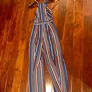 Festive  sexy jumpsuit by Bebe